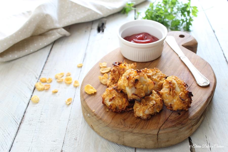 Bocconcini di pollo con i corn flakes cotti in forno